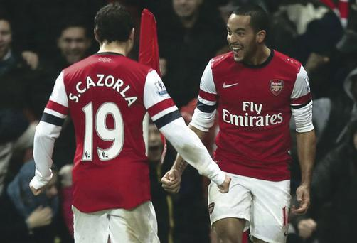 Late joy: Theo Walcott celebrates after scoring in stoppage time