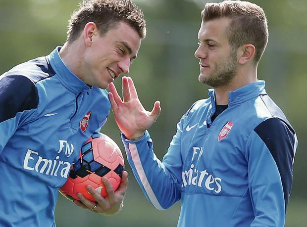Respect: Jack Wilshere (right) shares a joke with Laurent Koscielny during a training session yesterday