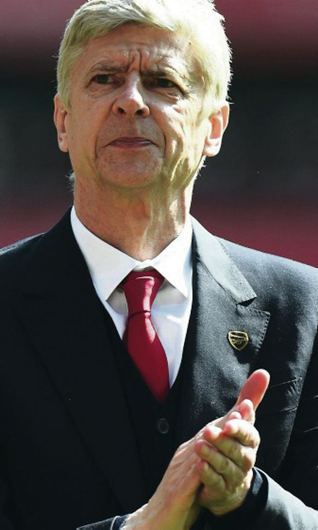 Sign on: Arsene Wenger has agreed new deal at Arsenal
