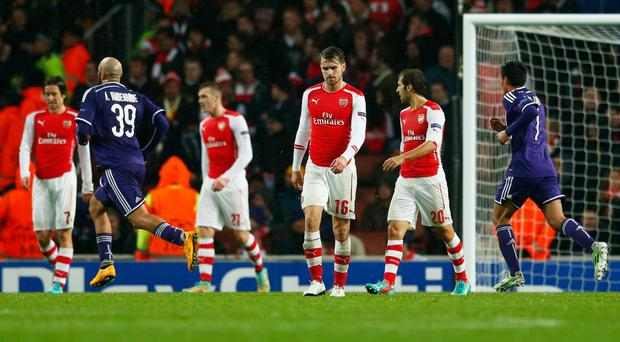 Sting in the tale: Arsenal players Tomas Rosicky, Lukas Podoloski, Aaron Ramsey and Mathieu Flamini look dejected after conceding a 90th minute equaliser to Anderlecht, having led the game 3-0