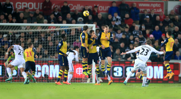 Sweet spot: Gylfi Sifurdsson scores a spectacular free-kick to equalise for Swansea against Arsenal yesterday