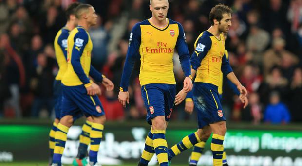 Feeling down: Arsenal's Calum Chambers trudges off after being given a red card against Stoke