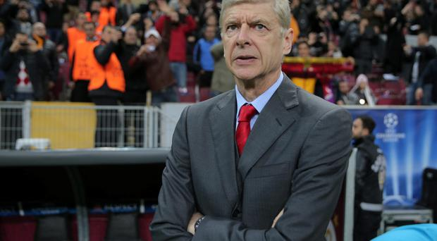 Under pressure: But Arsene Wenger says he has to cope