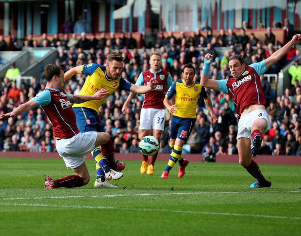 Powering through: Aaron Ramsey blasts home the only goal at Turf Moor to give Arsenal their eighth consecutive league win
