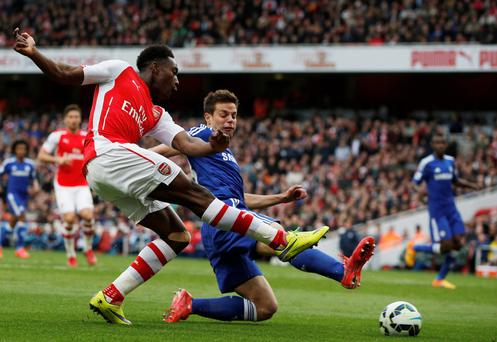 Gunning for goal: Arsenal's Danny Welbeck crosses the ball past Chelsea's Cesar Azpilicueta