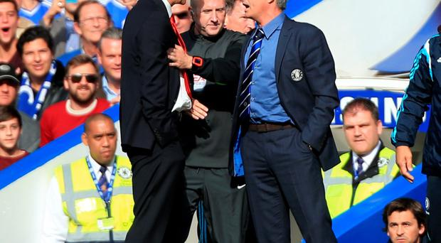 Big rivals: Arsene Wenger and Jose Mourinho have not seen eye to eye this season