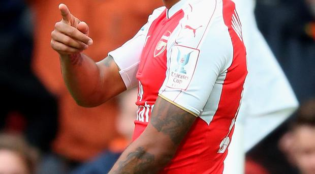 Staying put: Theo Walcott has pledged his future to Arsenal
