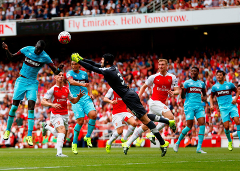 Beaten to the punch: Petr Cech fails to reach a cross, allowing Cheikhou Kouyate to open the scoring for West Ham