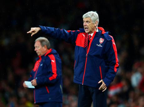 Shouting the odds: Arsene Wenger roars instructions to Arsenal last night but must make his voice heard in the transfer market