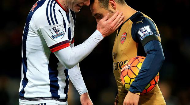 Bad miss: Craig Gardner with Santi Cazorla after his penalty