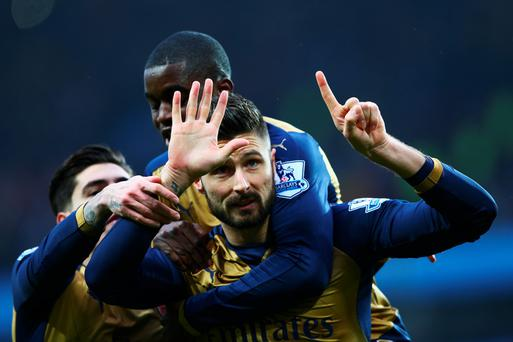 Spot-on: Arsenal's Olivier Giroud celebrates scoring the Gunners' first goal against Villa yesterday