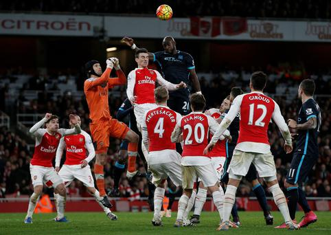 On the rise: Petr Cech leaps to punch away a corner during Arsenal's victory over Man City at the Emirates