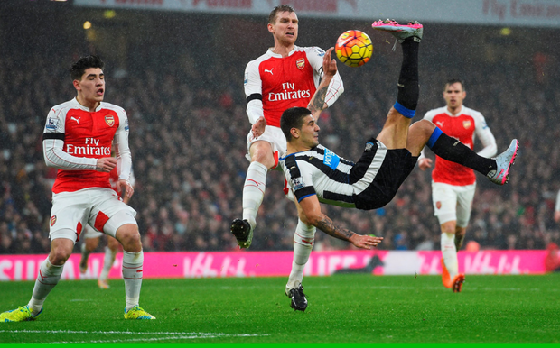 Off target: Aleksandar Mitrovic of Newcastle United attempts a bicycle kick against Arsenal