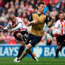 Tough test: Sunderland's Wahbi Khazri and Arsenal's Laurent Koscielny