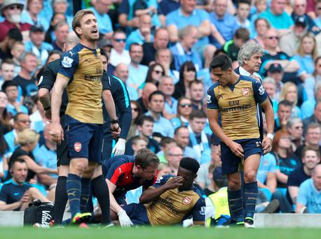 Wait: Danny Welbeck will undergo a scan to find out the extent of his injury