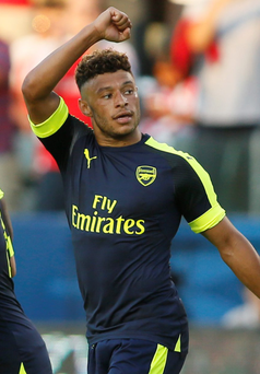 Flying start: Alex Oxlade-Chamberlain celebrates after scoring on Arsenal's pre-season tour to America following his return from a long-term knee injury