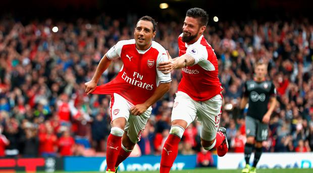 Late show: Santi Cazorla (left) celebrates his injury-time penalty winner with Oliver Giroud who was fouled to earn the spot kick
