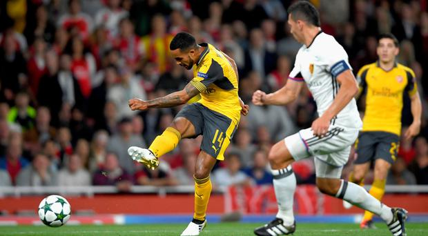 Doubling up: Theo Walcott bagged a brace to see off Basel at the Emirates