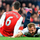 Floored: Harry Kane is taken out by Arsenal defender Laurent Koscielny