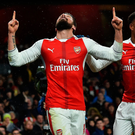 Wonder goal: Olivier Giroud salutes the crowd after his outrageous opener for Arsenal