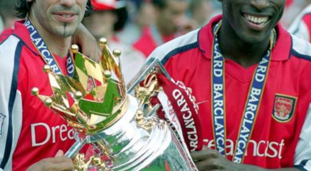 Question marks: Robert Pires and Sol Campbell are among the Arsenal legends to have taken aim at the Gunners' modern day stars