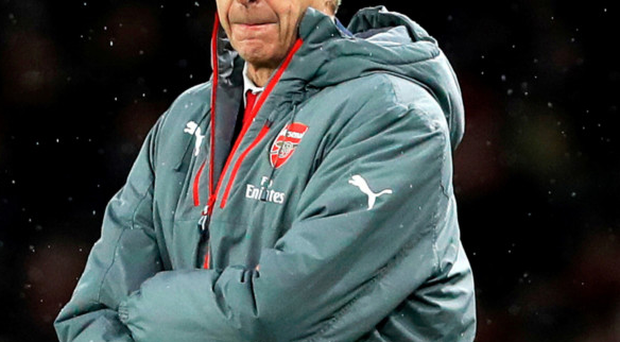 Long shot: Gunners boss Arsene Wenger is refusing to give up on title