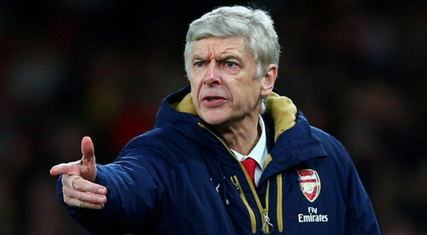 Decision time: Arsene Wenger will make a call over his Arsenal future this month or next, but insists he isn't seeking other jobs in the meantime