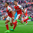 Final hurdle: Gabriel sets off in celebratory pursuit of Arsenal's winning scorer Alexis Sanchez
