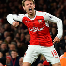 Joy: Nacho Monreal celebrates after his shot was deflected in