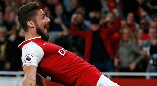 What a feeling: Olivier Giroud celebrates after scoring Arsenal's late winner at the Emirates last night
