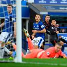 Setting the seal: Alexis Sanchez scores Arsenal's fifth in the rout of Everton