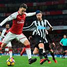 Forward march: Mesut Ozil closes in on goal during Arsenal's victory over Newcastle
