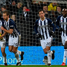 Last gasp: West Brom celebrate after Jay Rodriguez scored his late penalty yesterday