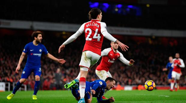 Big call: Eden Hazard is fouled by Hector Bellerin of Arsenal which leads to Chelsea being awarded a controversial penalty