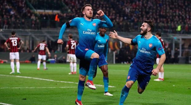 Jumping for joy: Aaron Ramsey celebrates after doubling Arsenal's advantage at the San Siro