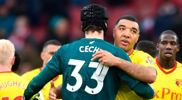 Petr Cech of Arsenal embraces Troy Deeney of Watford