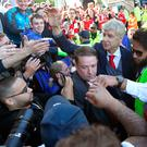 So long: Arsene Wenger is mobbed by Arsenal fans