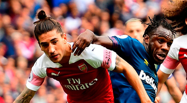 Winning way: Hector Bellerin clashes with Michail Antonio