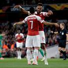 Double trouble: Pierre-Emerick Aubameyang celebrates his second goal of the night with Henrikh Mkhitaryan