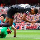 Top gun: Arsenal goalkeeper Petr Cech wins the ball at the feet of Everton's Dominic Calvert-Lewin