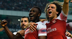 Decisive say: Danny Welbeck salutes his strike in Lisbon