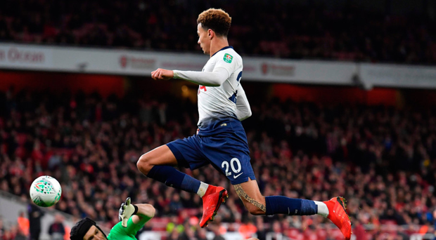 Chipping in: Dele Alli gets the better of Arsenal goalkeeper Petr Cech to put Spurs 2-0 up