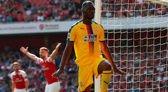 On target: Christian Benteke celebrates scoring against Arsenal