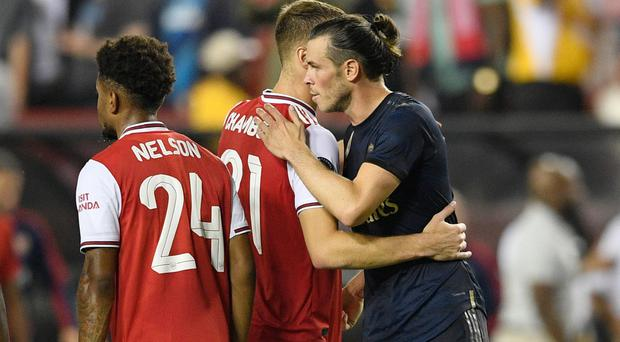 Shown the door: Real Madrid star Gareth Bale greets Arsenal defender Calum Chambers after the game
