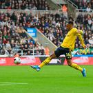 Cool finish: Pierre-Emerick Aubameyang slots home the winner for Arsenal