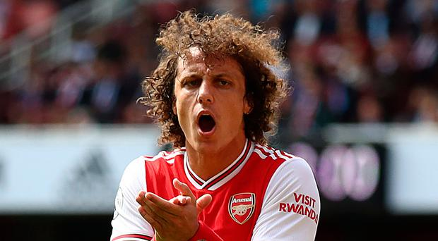 New colours: David Luiz rallies the troops on his Arsenal bow
