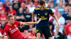 Well in: Jordan Henderson tackles Arsenal ace Dani Ceballos