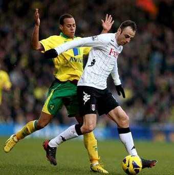 Norwich kept Dimitar Berbatov, right, at bay but are still without a win in nine league games