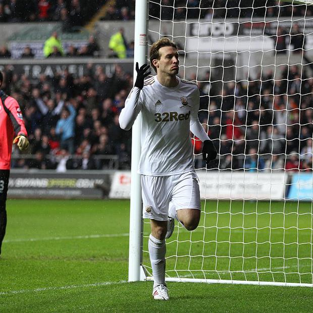 Michu bagged a brace as Swansea eased to victory over QPR