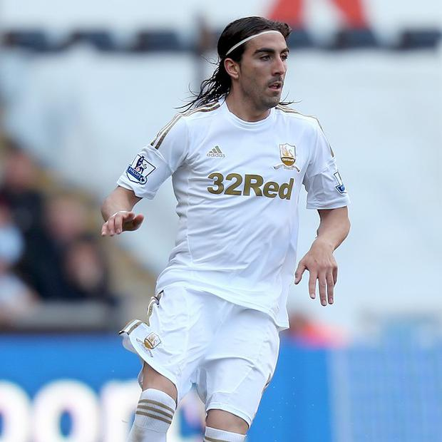 Chico Flores was stretchered off for Swansea after twisting his ankle
